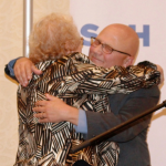 Ruth Hollman hugs honoree Allen Berger.